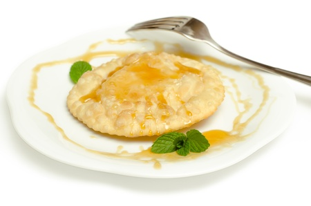 Sebada, typical Sardinian dessert, filled with cheese and topped with honey Stock Photo - 18882573