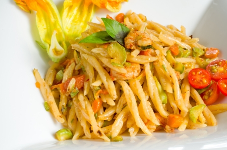 pastasciutta: Trofie with zucchini flowers and shrimps sauce,mediterranean cuisine