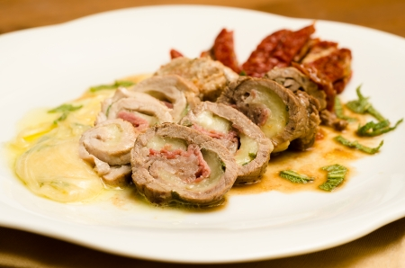 Beef rolls stuffed with cheese and ham, italian cuisine
