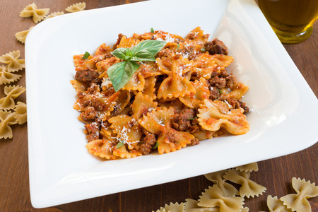 Farfalle with ragout sauce, italian cuisine Stock Photo