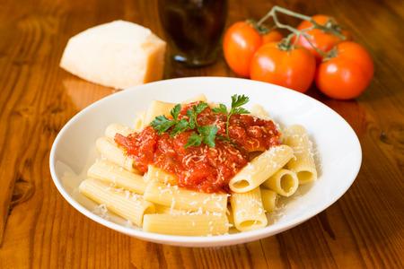 Rigatoni with tomato sauce and parmesan cheese, Italian cuisine