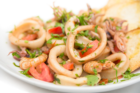 cuisines: Dish of boiled seafood with sauce Stock Photo