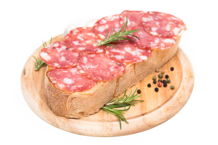 italian salami: Slice of bread with italian salami