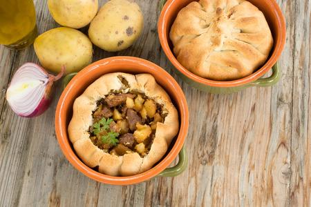 Panada, savory pie stuffed with meat and potatoes, Sardinian Food