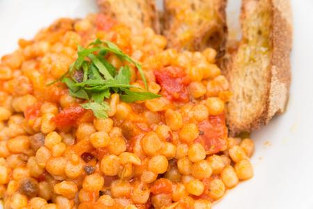 rutting: Rutting with tomato sauce, Sardinian Pasta Stock Photo