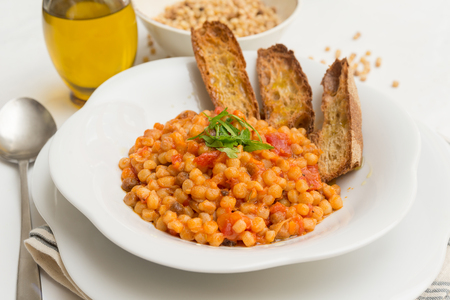 Rutting with tomato sauce, Sardinian Pasta Archivio Fotografico
