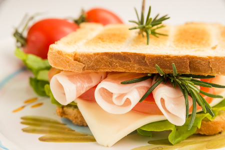 toasted sandwich: Toasted sandwich with ham, cheese and lettuce Stock Photo