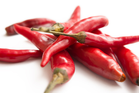 agri: Chili peppers on white