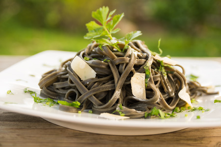 Noodles with squid ink, Italian Pasta Stock Photo