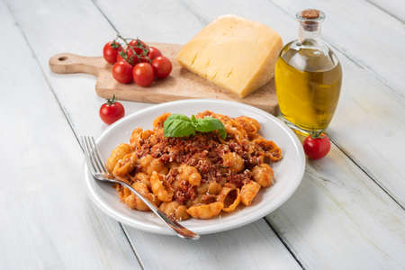 Dish of delicious gnocchi with bolognese sauce, Italian Cuisine Stock Photo