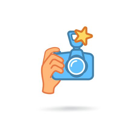 Digital photo camera in hand