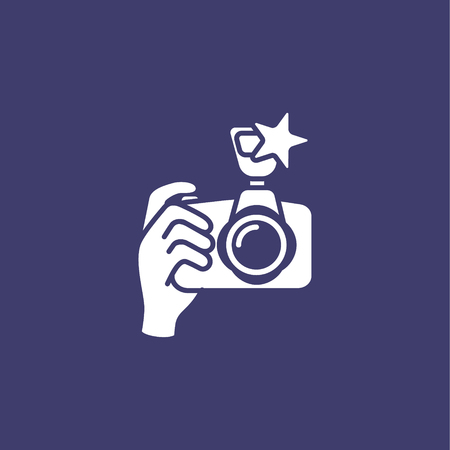 Digital camera on hand 向量圖像