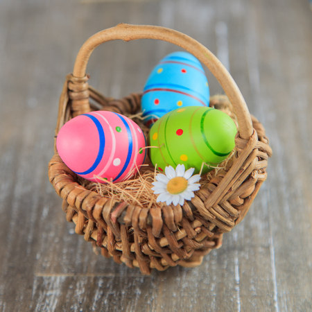 colourful easter eggs in a nest