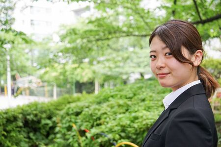 Young business woman working with a smile Stock Photo