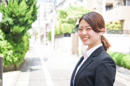 Young business woman working with a smile