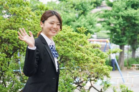 Student waving her hands with smile