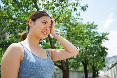 Young woman getting sweaty outdoors