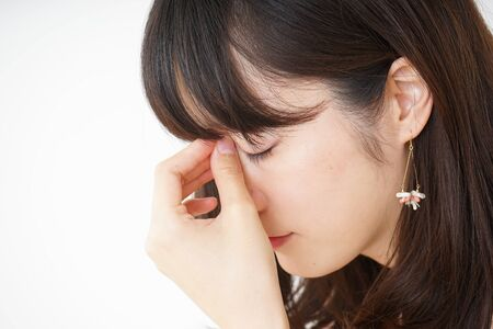 Young woman suffering from a headache