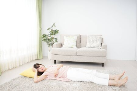 Young woman sleeping at home 写真素材