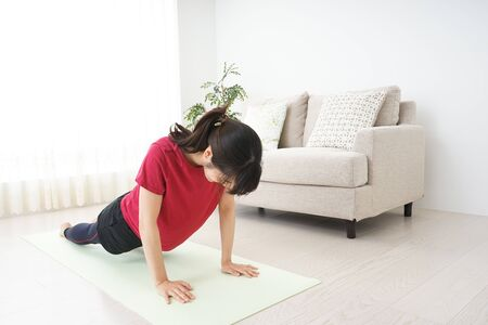 Young woman doing muscle training