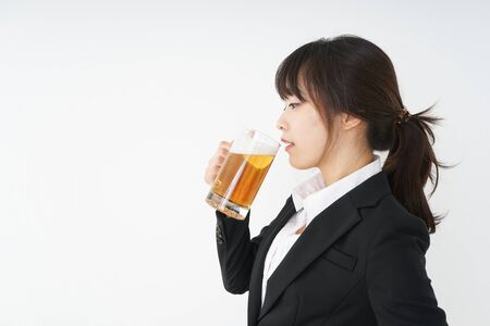 Businesswoman in suit cracking a beer