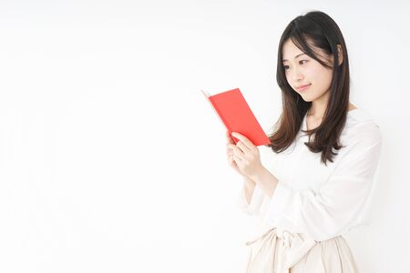 Young woman taking a note