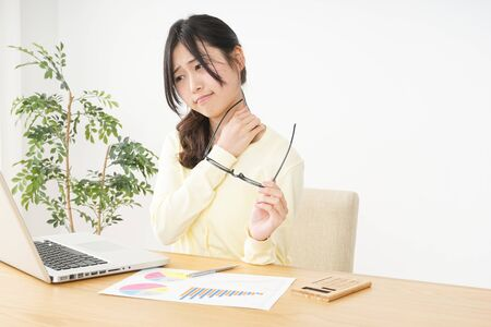 Young woman being be fatigued with office work