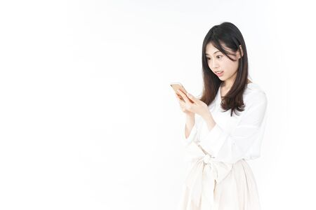 Young woman using smartphone 스톡 콘텐츠