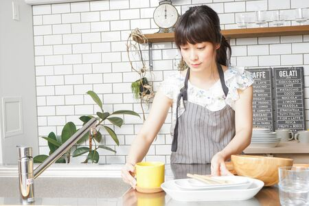 Cooking young woman Stok Fotoğraf