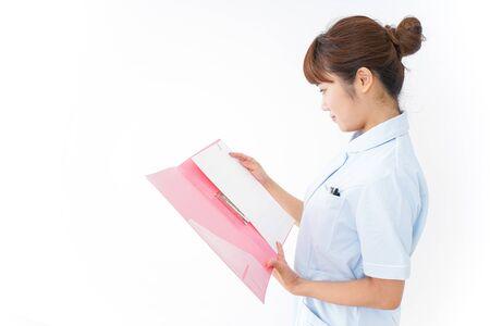 Nurse holding file