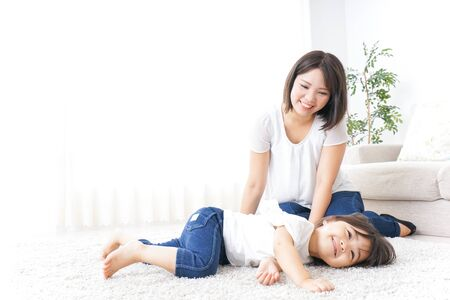 Child playing at home with mother