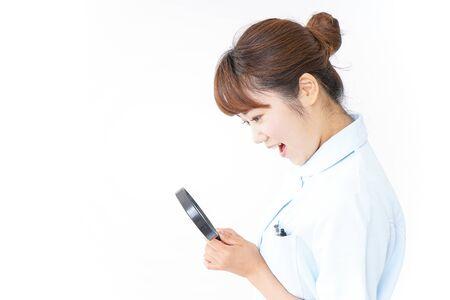 Nurse having loupe