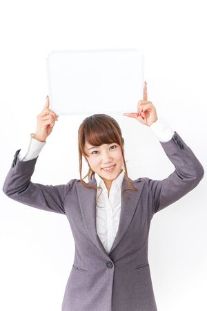 Business woman having a white board Imagens