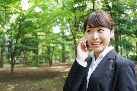Business woman talking on phone Banco de Imagens