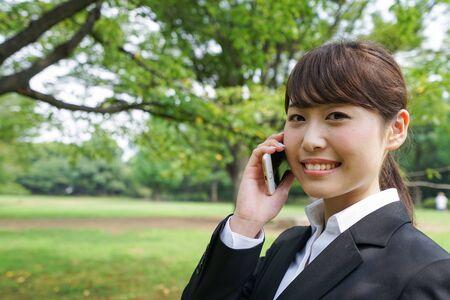 Business woman calling outside