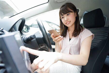 Woman using car navigation