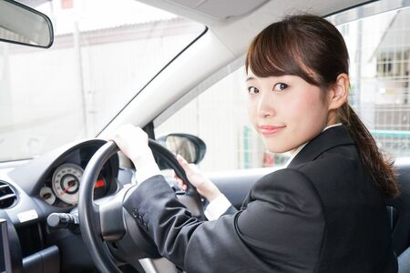 Young business woman in car