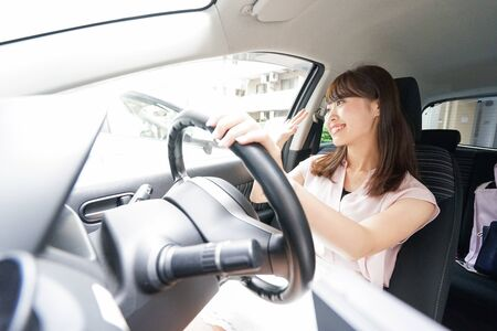 Woman driver waving her hands
