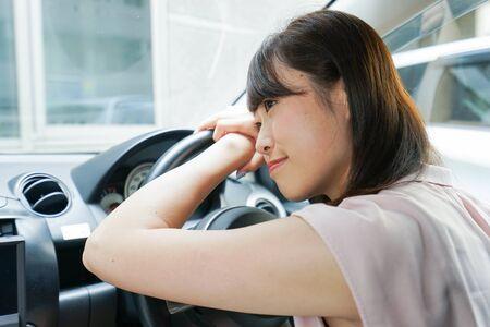 Young woman sleeping in car