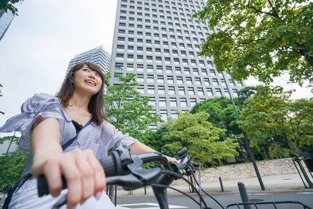 Woman riding bicycle Banco de Imagens