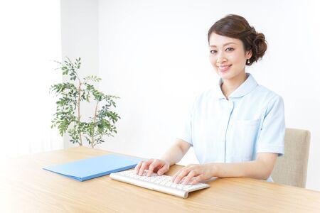 nurse using computer Stock Photo