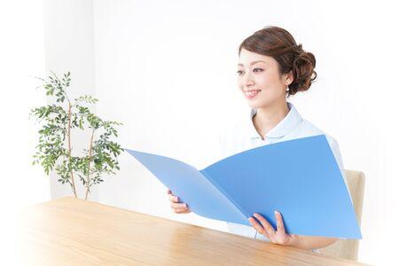 nurse reading documents