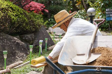 Elderly man doing earth works