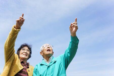 Senior couple poointing something