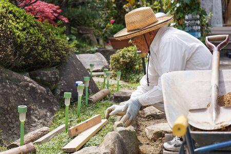 Elderly man doing earth works