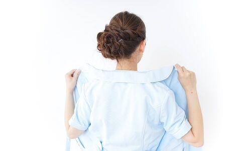 nurse getting dressed Stock Photo