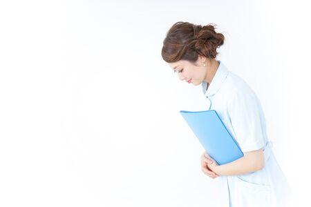 nurse bowing to someone