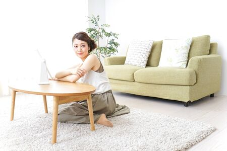 woman making herself up at home 写真素材