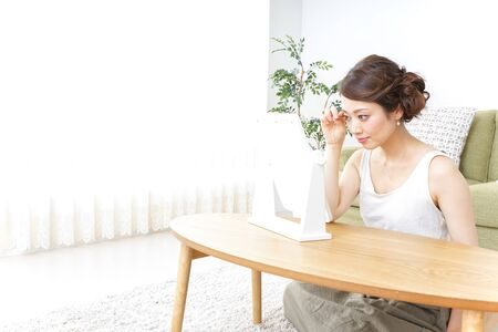 woman making herself up at home Stock fotó