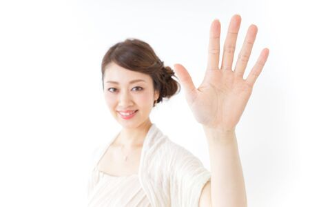 woman in dress waving her hands